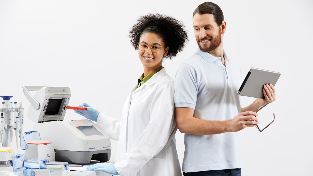 Two laboratory technicians with PCR and portable lab software solution VisioNize