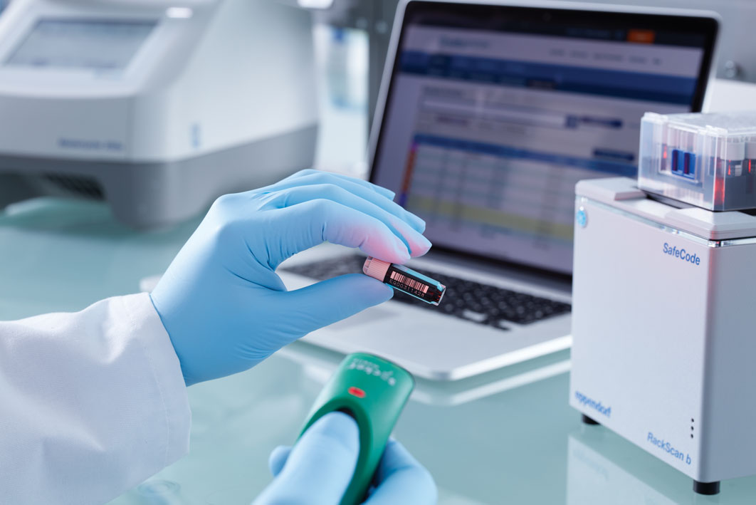 : Scientist's hand scanning CryoStorage Vial in digital lab