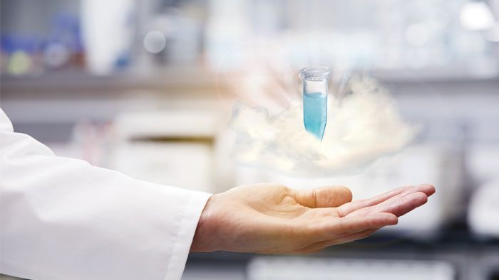 Scientist's hand holding sample in cloud - maintenance management software VisioNize® Lab Suite.