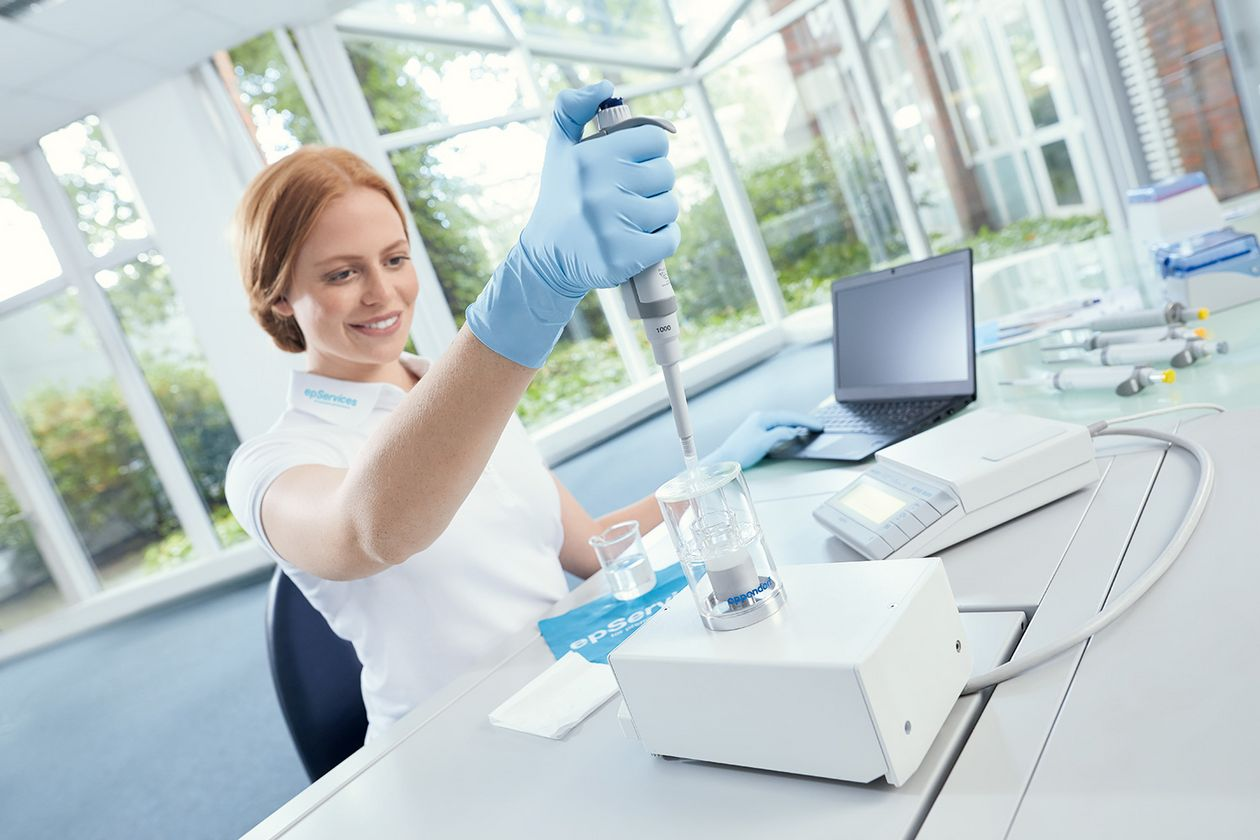 Woman  calibrating a pipette in the lab