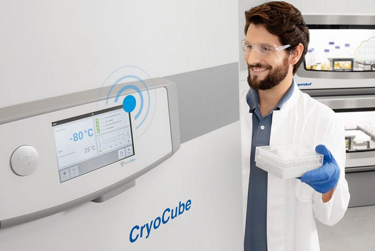 Man opening a smart freezer by Eppendorf to store valuable samples.