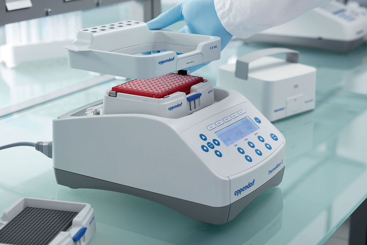 Scientist installs further equipment at Eppendorf ThermoMixer.