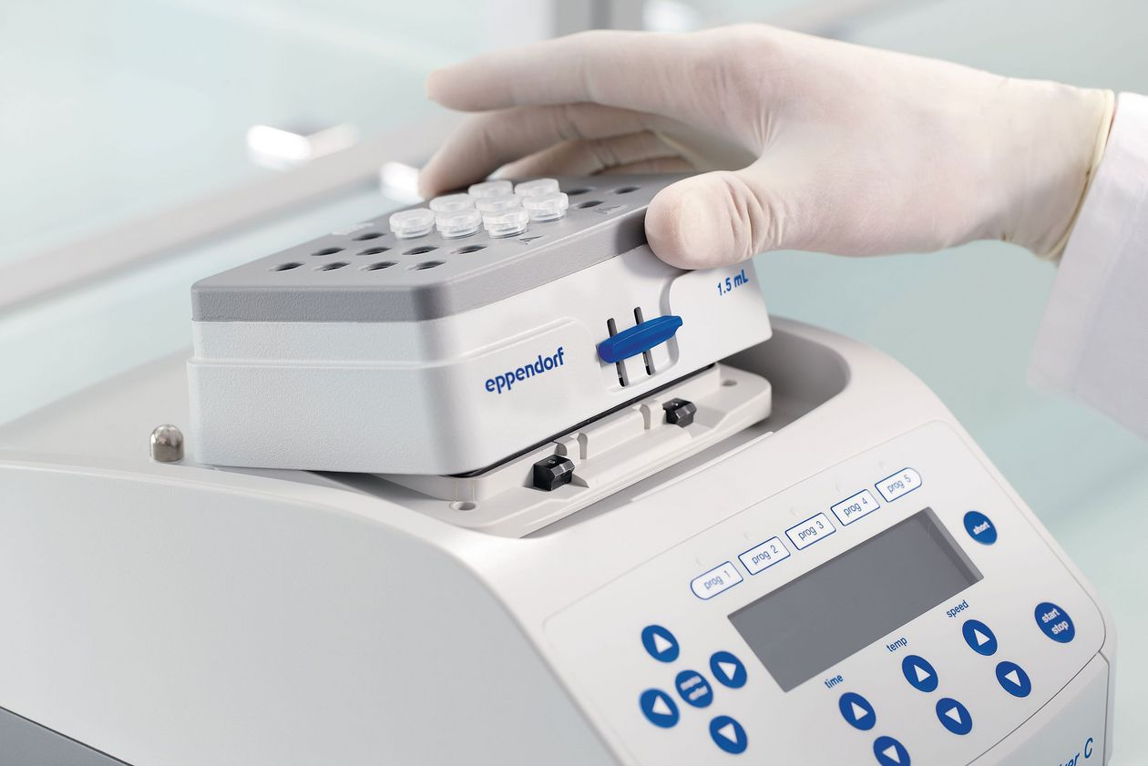 Scientist exchanges thermoblock of an Eppendorf Thermomixer instrument.