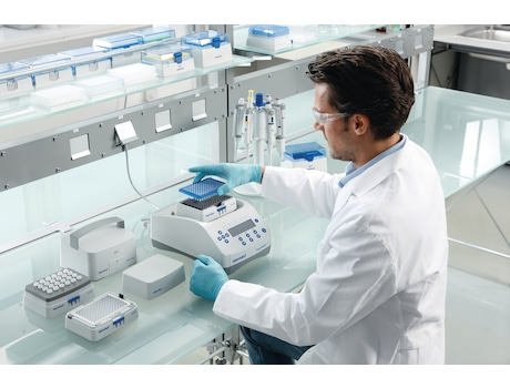 Eppendorf ThermoMixer C with lab scientist who puts 96 well plate on SmartBlock