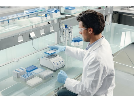 Image – Scientist puts plate on Eppendorf MixMate to mix samples