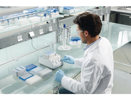 Lab scientist changes settings of Eppendorf MixMate instrument